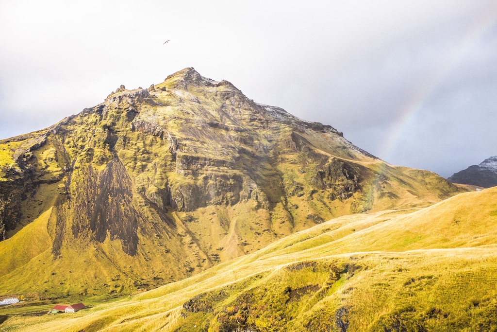 Yellow mountain and rainbow - off the beaten track in Iceland