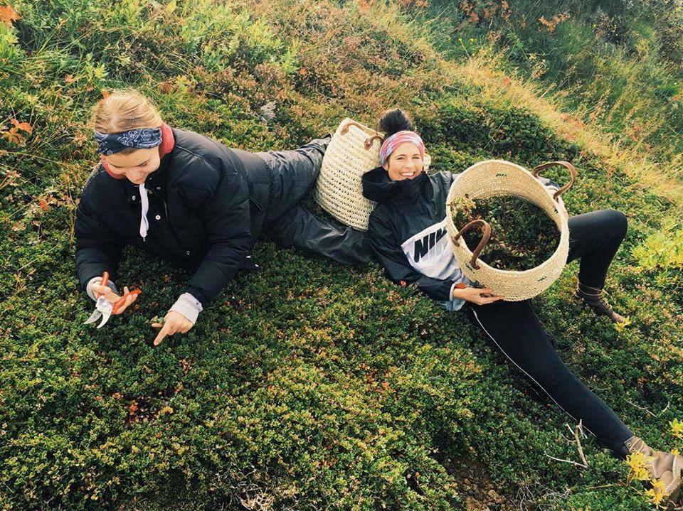Girls picking herbs